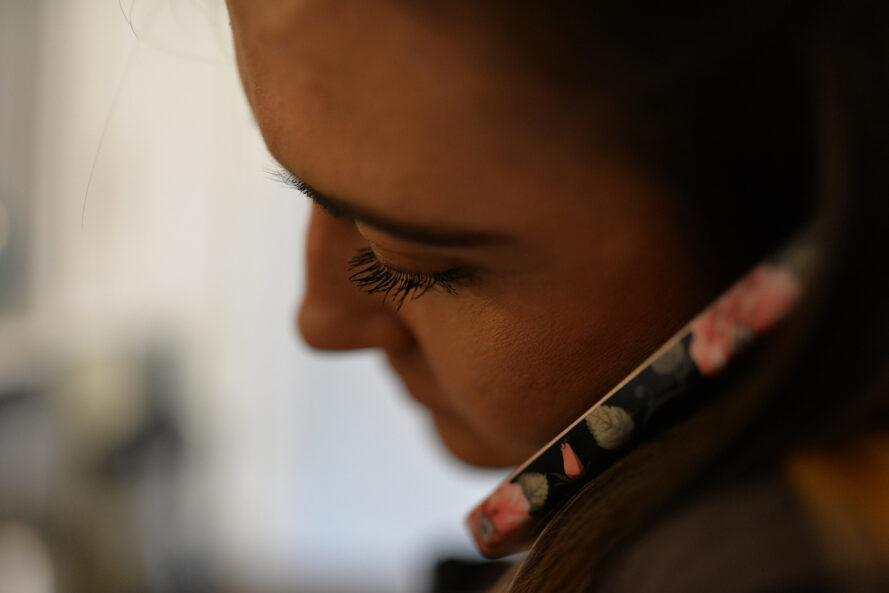 close-up of person talking on cellphone