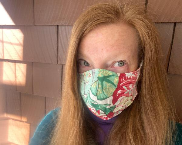 person wearing patterned face mask