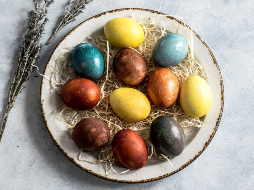 naturally dyed eggs on a white plate