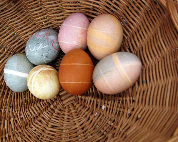 naturally dyed eggs with drawings on them