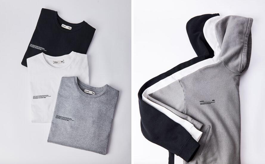 flat lay of folded gray, white and black T-shirts and sweatshirts