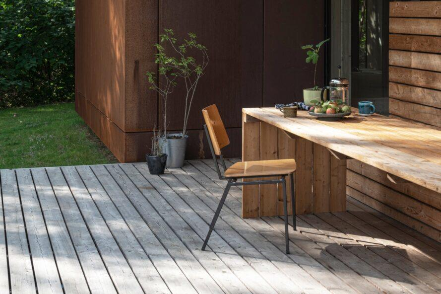 table and chair on an outdoor wooden deck