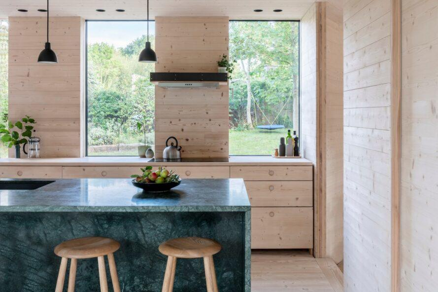 light wood-lined kitchen with a dark gray island