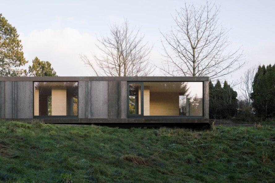 elongated home with large floor-to-ceiling glass panels