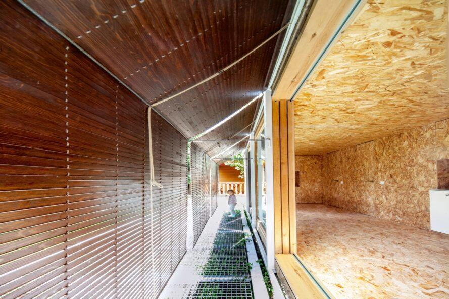 an exterior walkway with roll up shutters