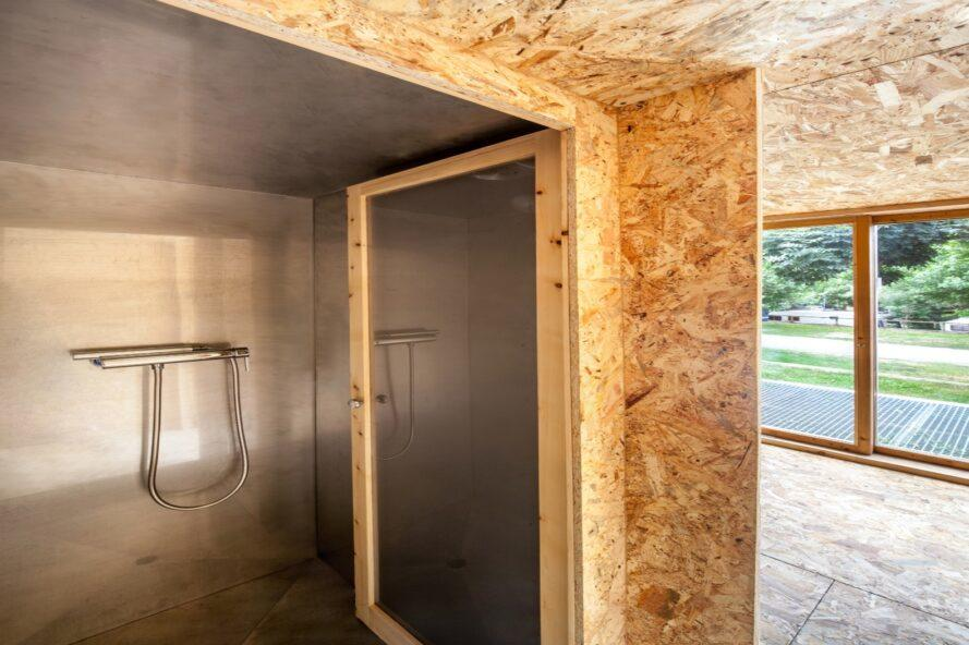 shower space inside plywood room