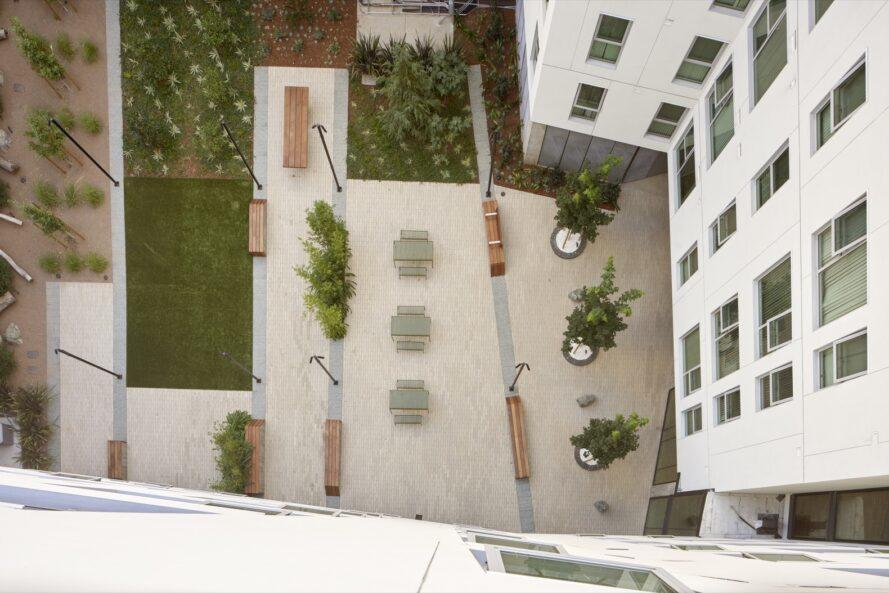 aerial view of courtyard filled with plants and seating areas