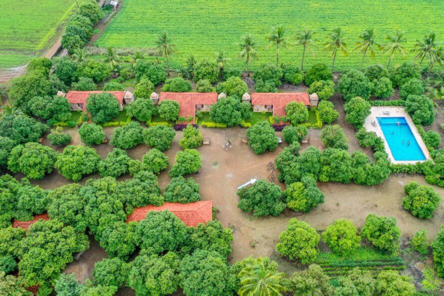 aerial view of cottages with terracotta roofs on a farm