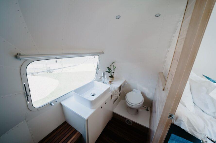 bathroom with white sink area and a small window