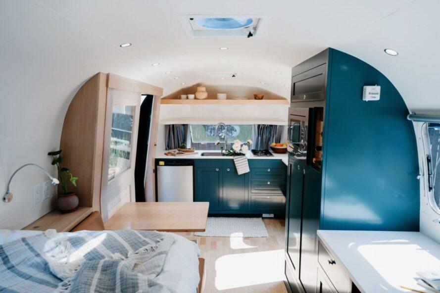 dark green kitchen cabinets inside an Airstream