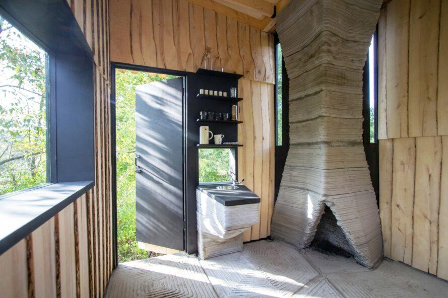 wood cabin interior with large concrete chimney