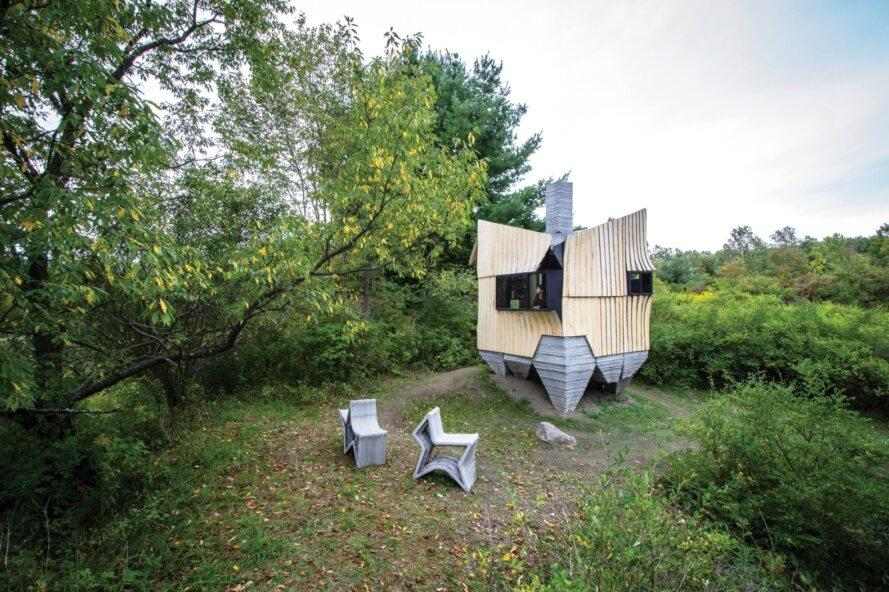 geometrical cabin surrounded by a forest