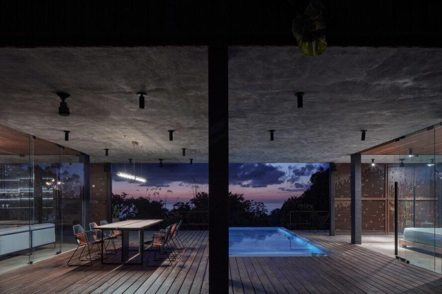 covered outdoor space with pool and dining table