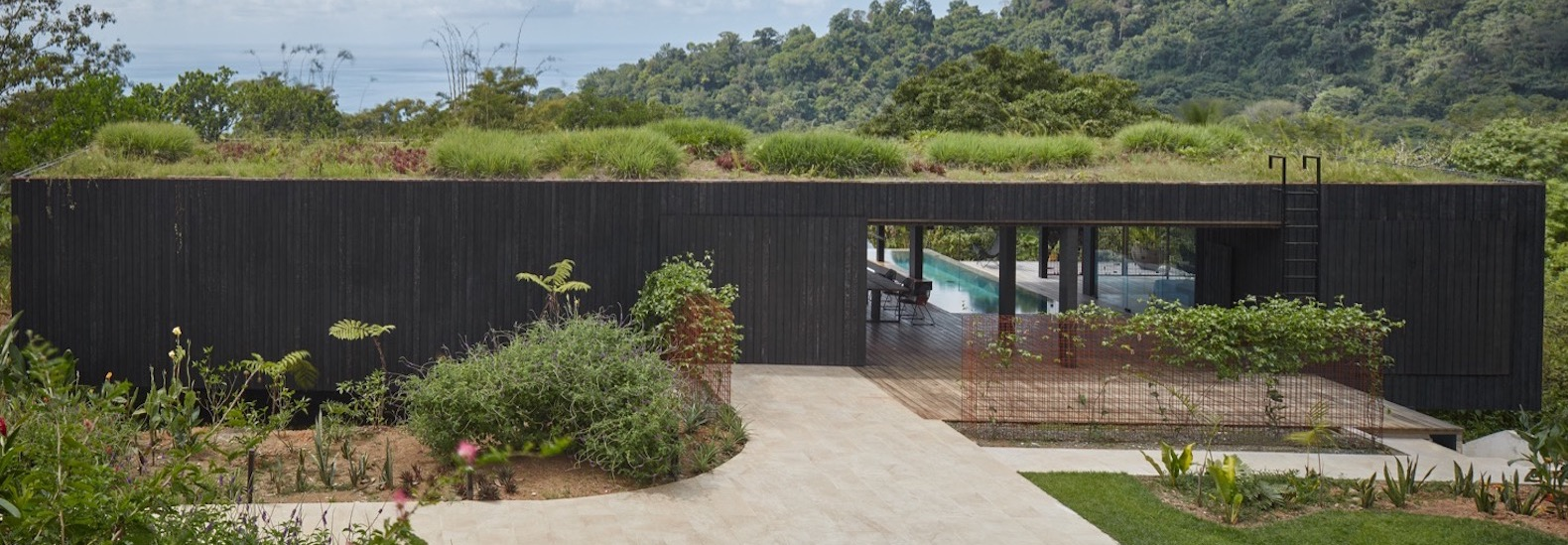 Green-roofed villa blends into a Costa Rican jungle landscape