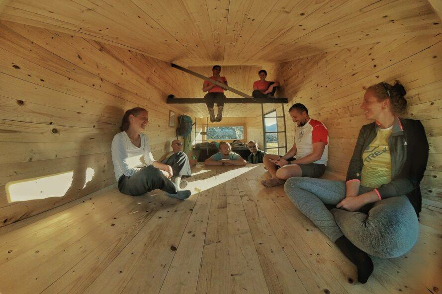 group of people in a tiny wooden space