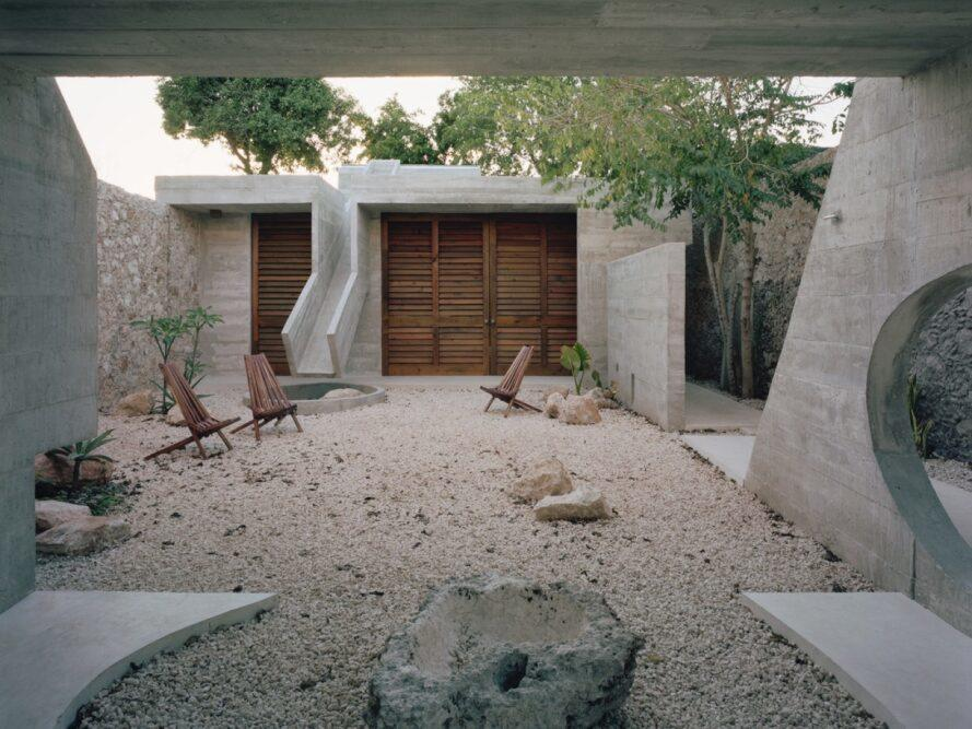 rocks and lounge chairs in a courtyard