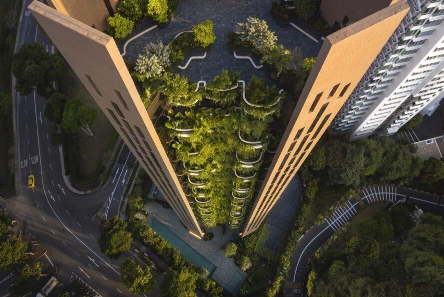 aerial view of tall brown building with a wall of plants
