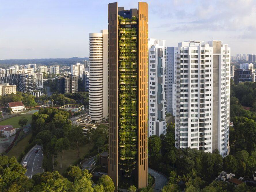 tall brown building with a wall of plants