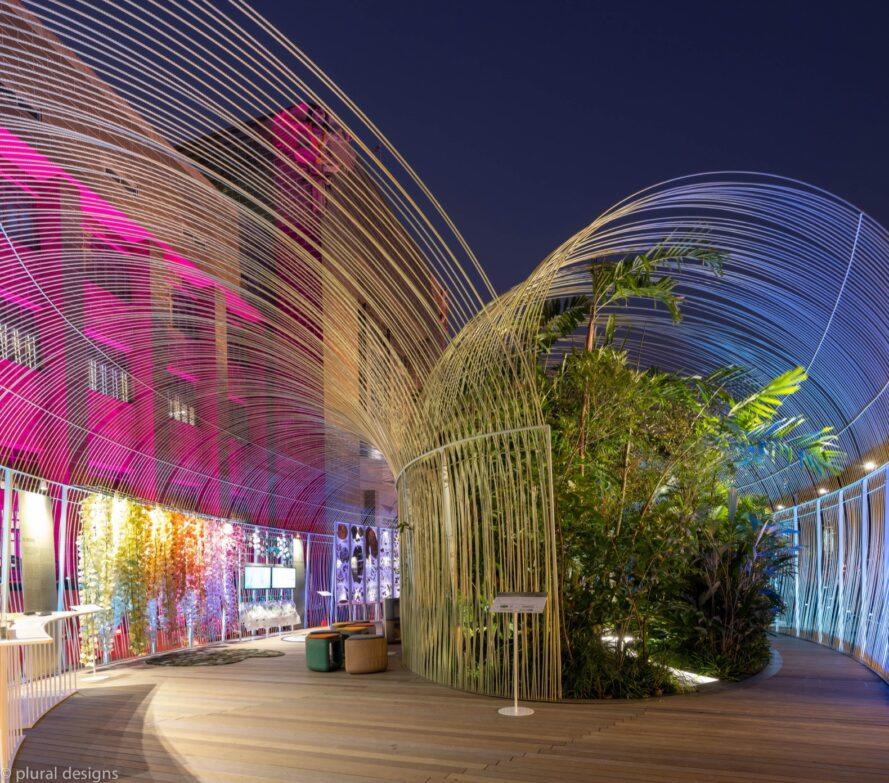 clear, tunnel-shaped pavilion filled with plants