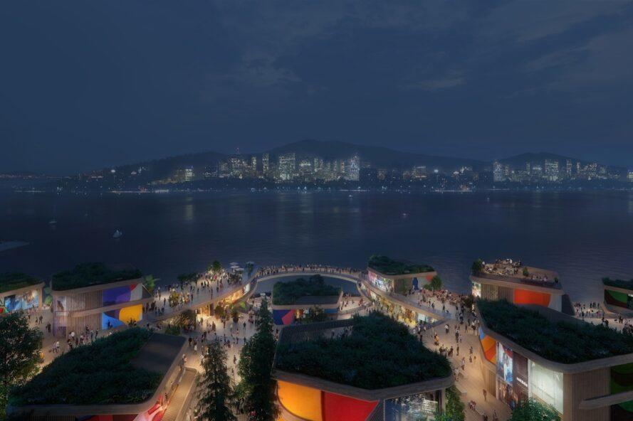 rendering of green-roofed buildings facing water at night