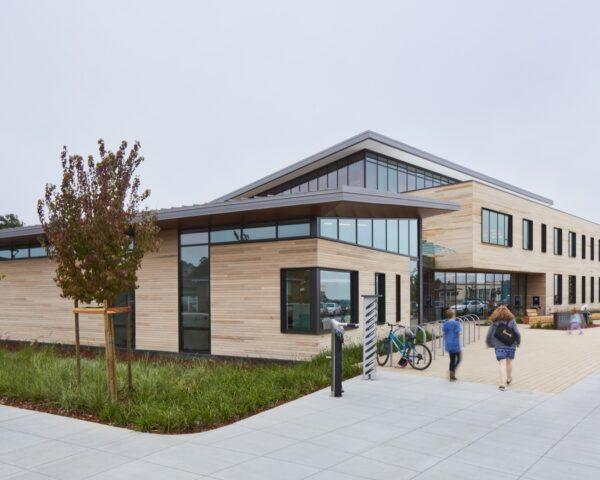 wood-clad library building with slanted roof