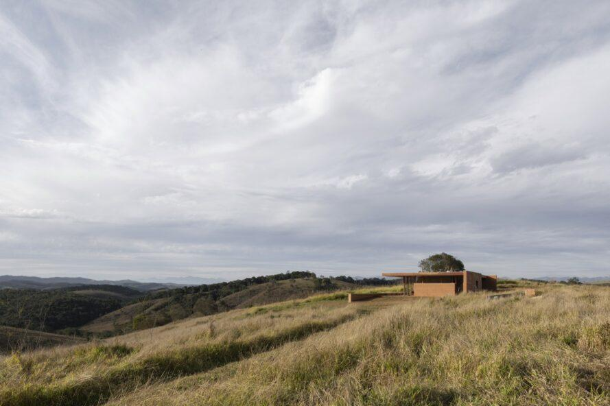rammed earth home on a hill