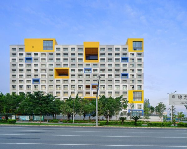 a multi-story building with pops of blue and yellow