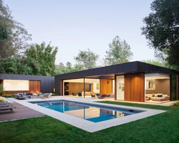 dark gray and wood home near a pool