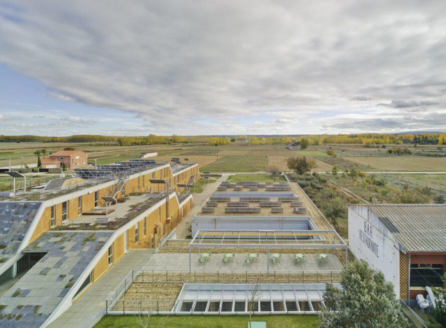 aerial view of tan buildings covered in solar panels