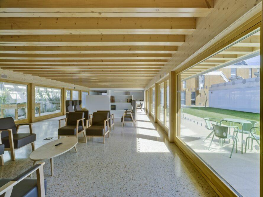 dark chairs in a communal living area with wood-beamed ceilings