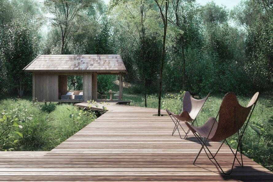 wooden walkway leading up to pitched roof cabin