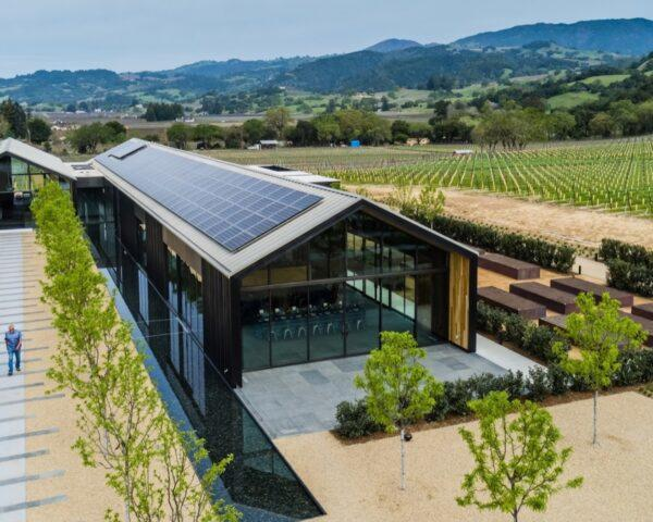 angled view of gabled winery building with solar panels on the roof
