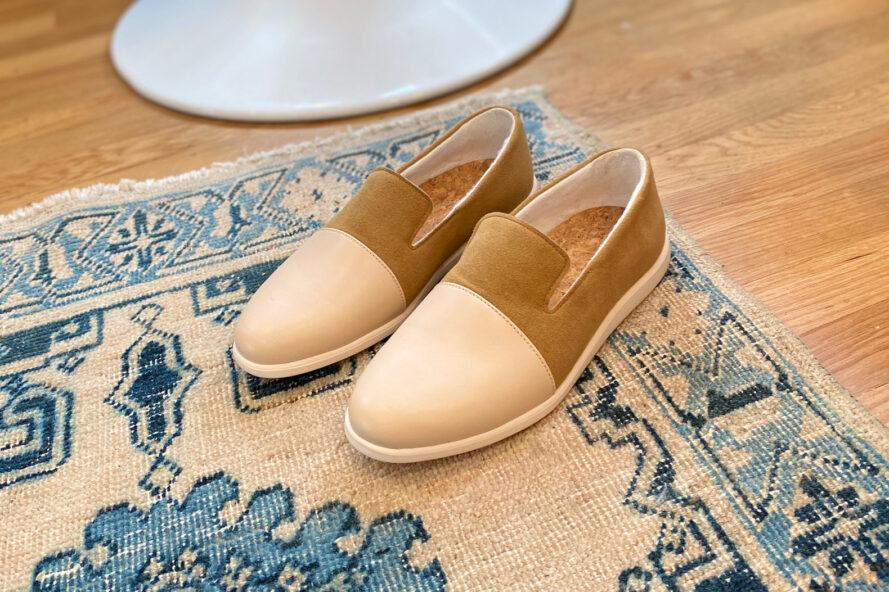 tan and beige loafers on a patterned rug