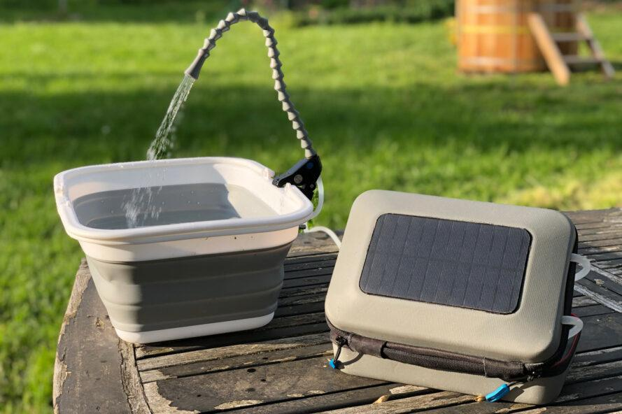 solar panel set up on table and connected to small hand washing station