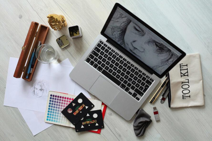 art supplies in front of a laptop