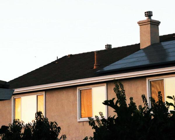 solar panel system on a cottage roof
