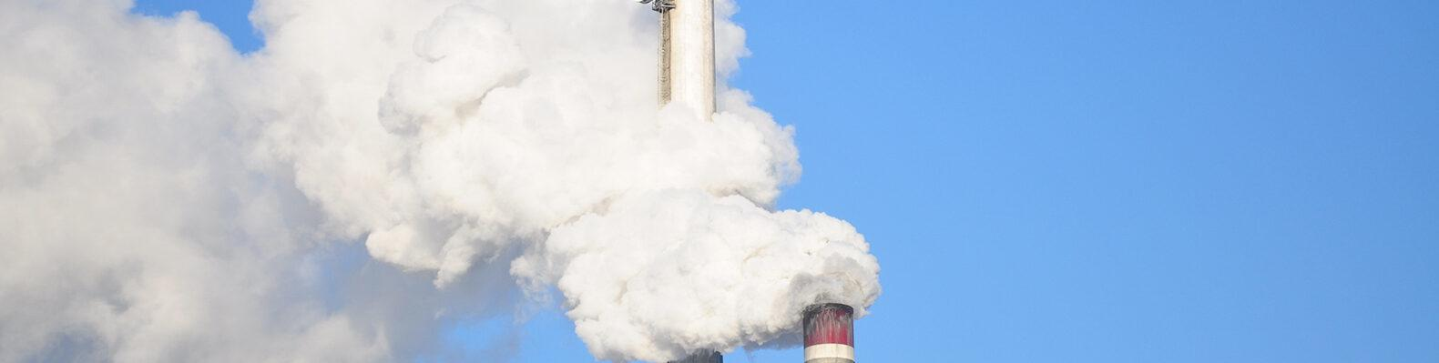 smoke stacks against a blue sky
