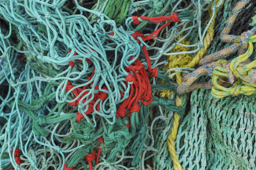 closeup of blue, teal, red and yellow colored fishing nets
