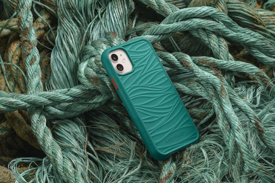a phone in a teal case on a pile of old fishing nets and ropes