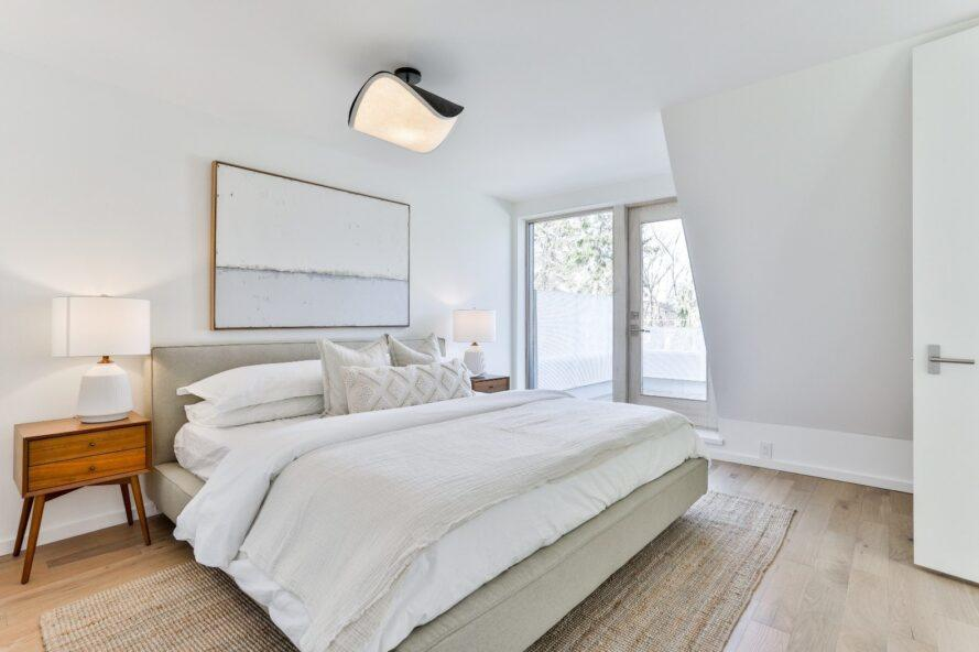 white bed in a white bedroom