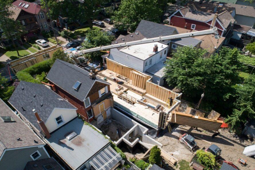 aerial view of people building a narrow home
