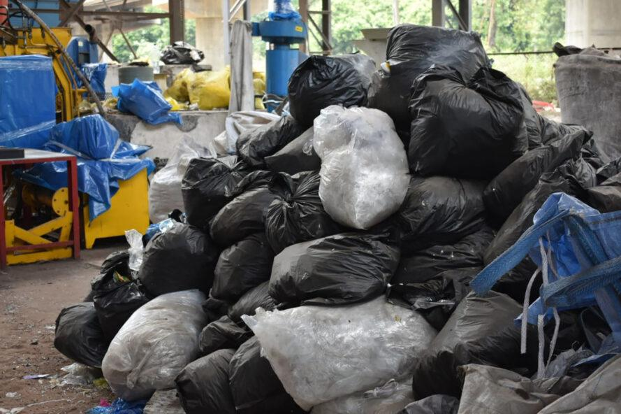 a pile of trash bags full of plastic waste
