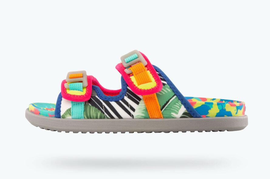 a multi-colored sandal with pink, yellow and blue accents against a white background