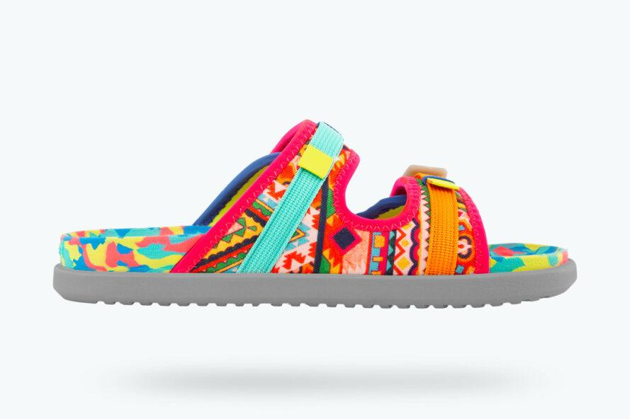 a multi-colored sandal with pink, orange and blue accents against a white background