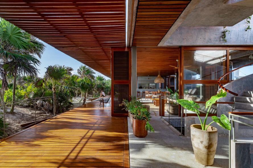 a deck with wood accents connected to the interior of a villa