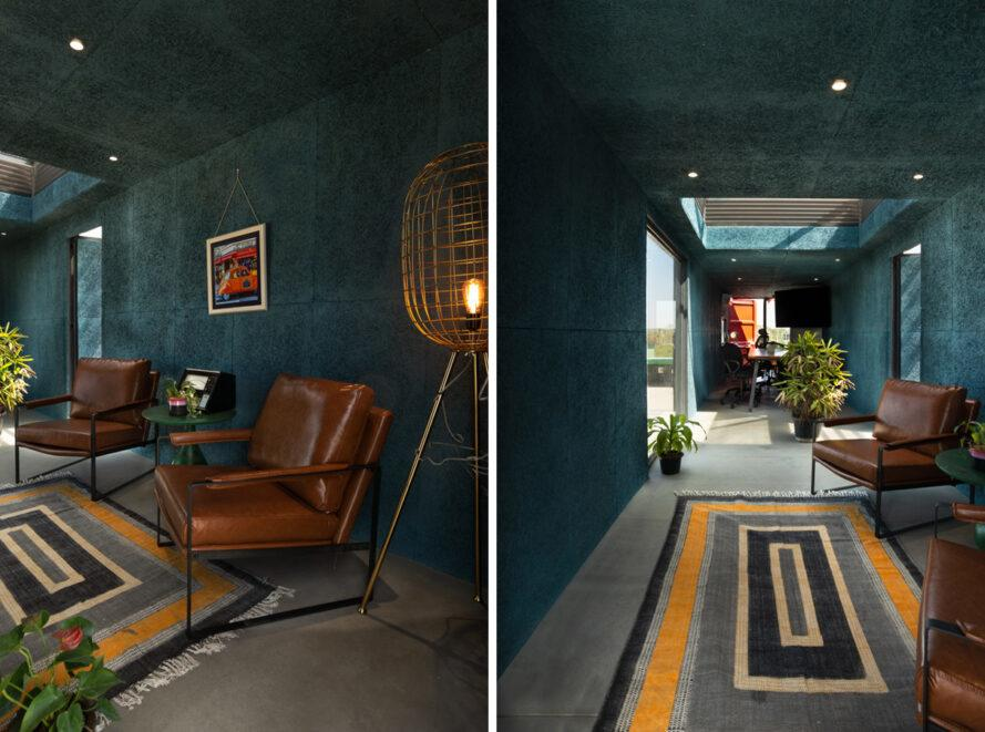 teal room with tan leather chairs and a light with a brass cage lampshade