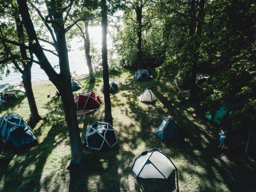 birds-eye view of a camp site with several geodesic tents set up