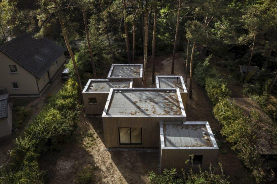 aerial view of home with five cube volumes surrounded by trees