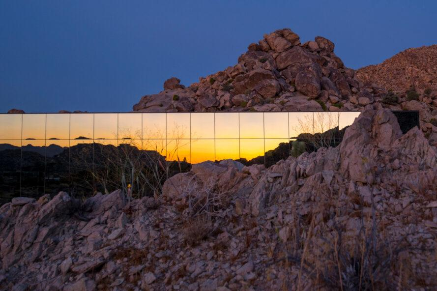mirrored home reflecting view of sunset