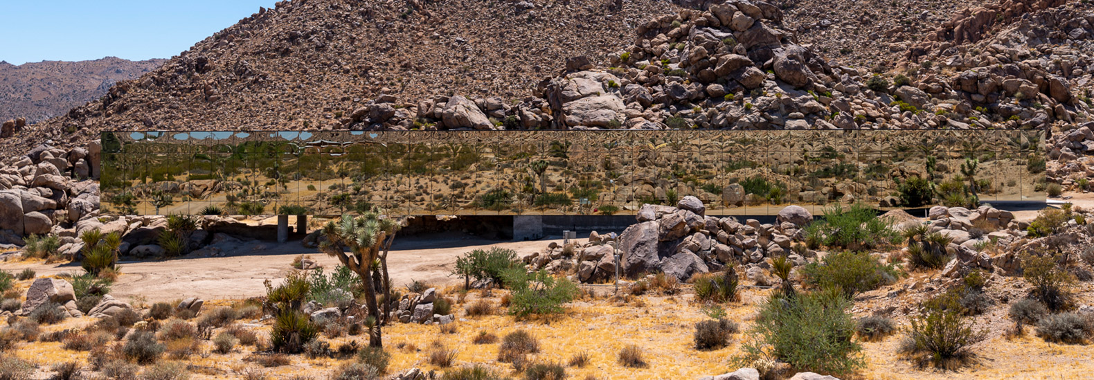 The Invisible House is a reflective building that mirrors its desert surroundings